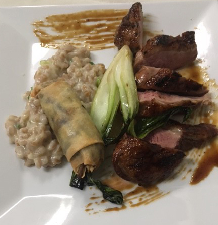 Duck oriental with maitake spring rolls and soy farro risotto