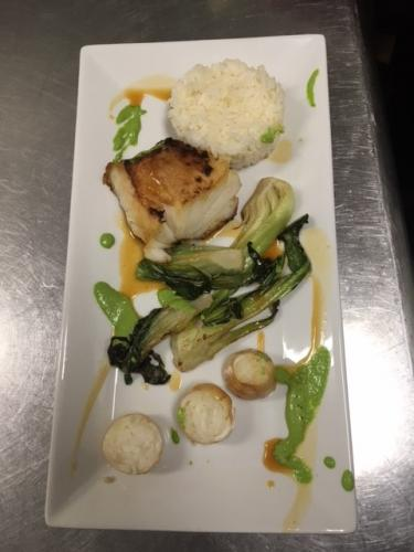 roasted miso codfish with rice stuffed calamari baby bok choy and orange ginger sauce